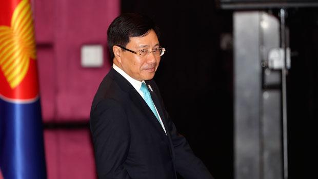 Vietnam's foreign minister Pham Binh Minh walks into an ASEAN meeting in Bangkok, July 31, 2019.