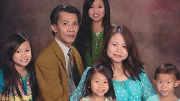 Michael Phuong Minh Nguyen poses with his wife and four young daughters in an undated photo.