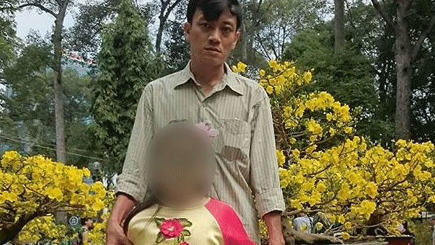 Facebook user Huynh Anh Khoa is shown with his daughter (face obscured) in an undated photo.