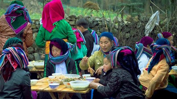 In this file photo, Vietnamese Hmong feast during a funeral.