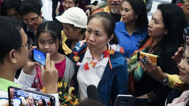 Vietnam dissident blogger Nguyen Ngoc Nhu Quynh (C) is surrounded by well-wishers as she arrives at Houston George Bush airport in Houston, Texas, in handout photo released and taken by Amnesty International, Oct. 18, 2018.