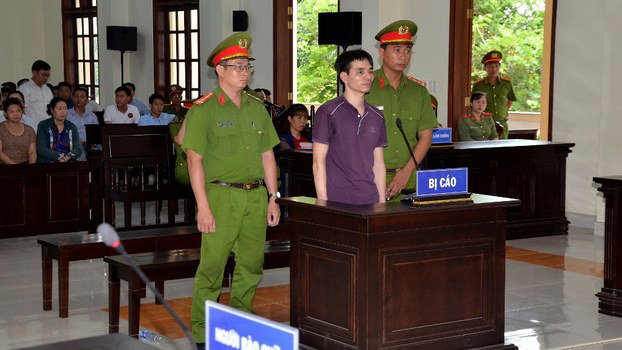 Environmental activist Nguyen Ngoc Anh stands trial at the People's Court of Ben Tre province, Vietnam on June 6, 2019.