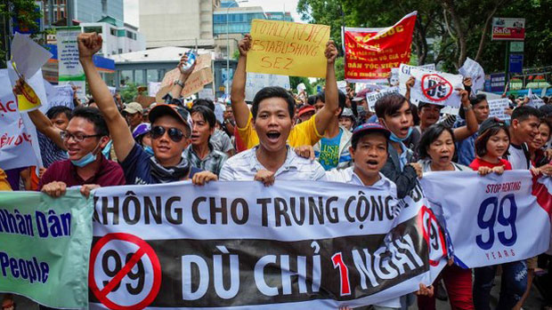 Residents of Ho Chi Minh City protest proposed laws granting land to foreign businesses and restricting freedom of discussion online, June 10, 2018.