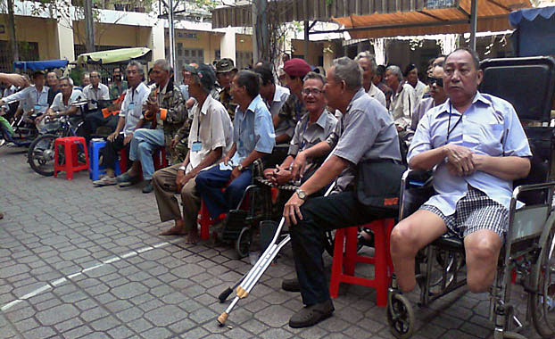 Wounded and disabled South Vietnamese military war veterans attend an event hosted by the Saigon Redemptorist Church in south Vietnam's Ho Chin Minh City in an undated photo.
