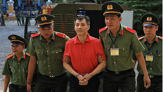 Michael Nguyen is taken to court for his trial in Vietnam's Ho Chi Minh City, June 24, 2019.