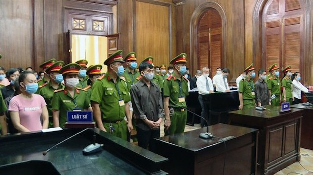 Vietnamese democracy activists are shown at their trial in Ho Chi Minh City, July 31, 2020.