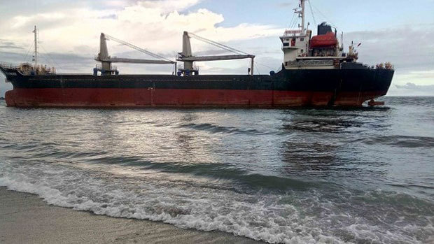 The Vietnamese cargo ship HTK Energy is pictured shortly after it ran aground off Sarangani Bay in the southern Philippines, June 18, 2018.
