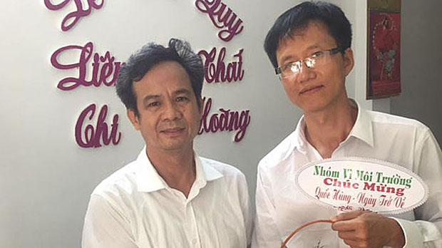 Vietnamese labor activist Nguyen Hoang Quoc Hung (R) is shown following his release from prison, Feb. 24, 2019.