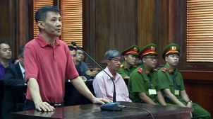 US citizen Michael Nguyen is shown at his trial in Ho Chi Minh City, June 24, 2019.