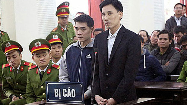 Hoang Duc Binh (R) is shown at his trial in Vietnam's Nghe An province, Feb. 6, 2018.