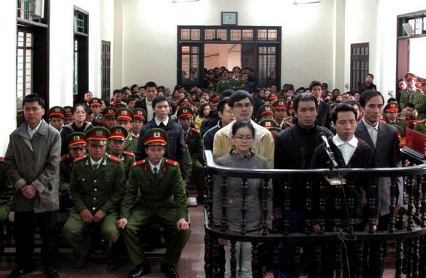 Activists convicted of plotting to 'overthrow' the government listen to their verdicts at a court in Vinh, Nghe An province on Jan. 9, 2013.