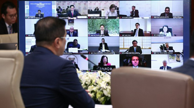 Mohamed Azmin Ali, Malaysia's minister for international trade and industry, views a monitor during the 2020 APEC trade ministers conference, July 25, 2020.