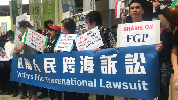 Vietnamese supporters of the group lawsuit against Formosa Plastics Group demonstrate in Taipei, Taiwan, June 11, 2019.