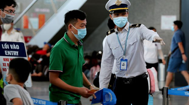 Medical personnel in Vietnam's Danang check city residents for signs of infection with COVID-19, July 26, 2020.