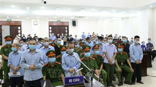 Villagers arrested following a deadly land-rights clash in Dong Tam commune in January are shown on trial in Hanoi, Sept. 8, 2020.