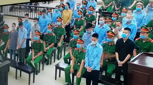 Defendants in Vietnam's Dong Tam case are shown in court on the trial's opening day, Sept. 7, 2020.