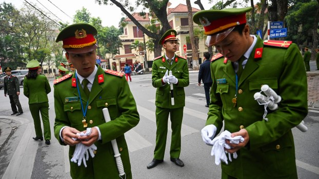 Vietnamese security personnel stand guard outside the North Korean embassy in Hanoi on February 26, 2019, ahead of the second US-North Korean summit.