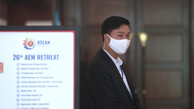 A security official wearing a face mask guards the entrance to ASEAN Economic Ministers' Meeting in Danang, Vietnam on Tuesday, March 10, 2020.