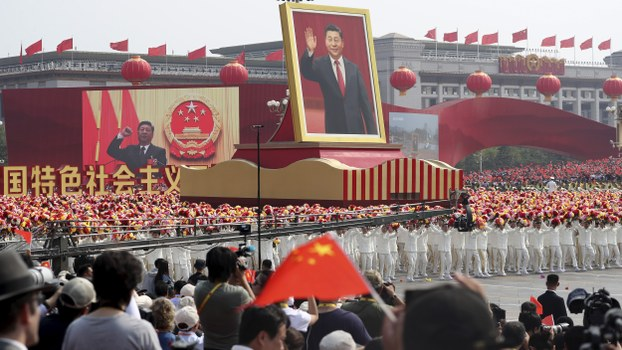 Chinese President Xi Jinping is shown in a painting and on screen during a parade for the 70th anniversary of the founding of the People's Republic of China in Beijing, Oct. 1, 2019.