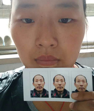 Liu Xia displays a photo of her father at her home in Hebei's Dingzhou city, in an undated photo. Credit: Liu Xia