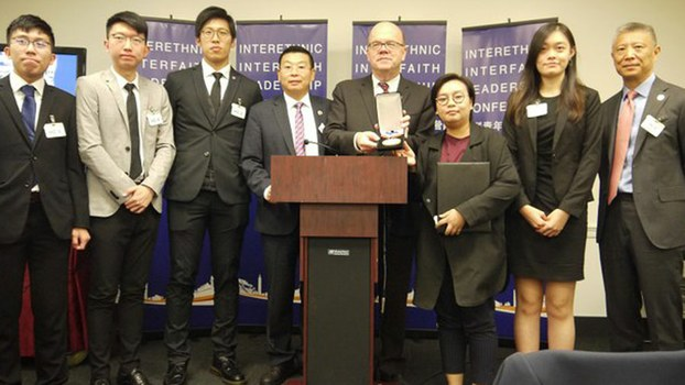 Bonnie Leung (2nd, Right), international spokeswoman for Hong Kong march organizers the Civil Human Rights Front, and colleagues receive the Citizen Power Award from the NGO Citizen Power for China, in Washington, Oct. 21, 2019.