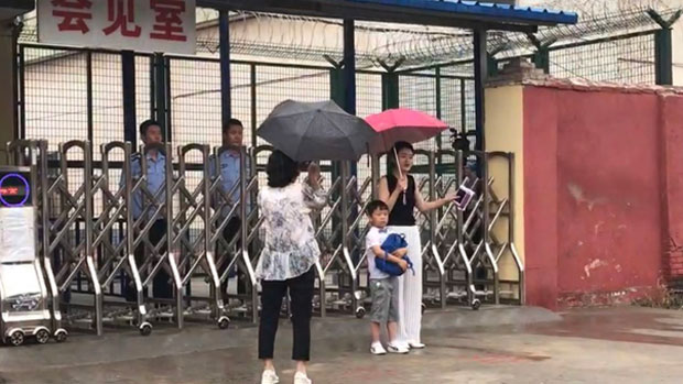 Li Wenzu (R) the wife of jailed human rights lawyer Wang Quanzhang, and the couple's six-year-old son Wang Guangwei, visit him in Linyi Prison in the eastern province of Shandong, June 28, 2019, the first time she has laid eyes on him since his initial disappearance in 2015.