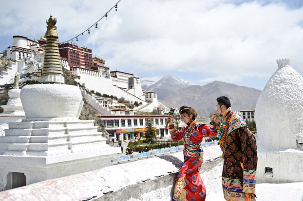 Newly-wed Tibetan couple visits the Potala Palace in an undated photo.