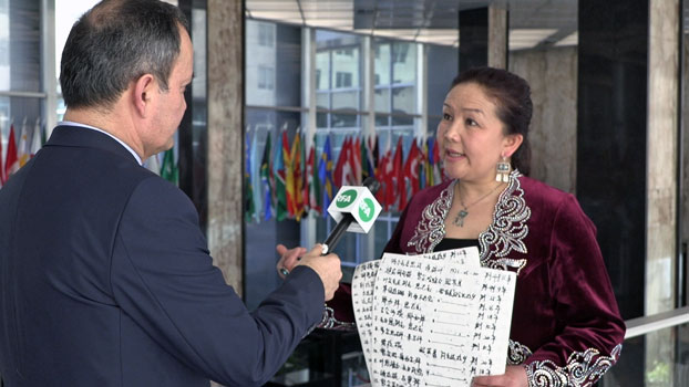 Sayragul Sauytbay (R) talks about her International Women of Courage Award and the detention centers for Muslims in northwestern China's Xinjiang region, outside the U.S. State Department in Washington, March 3, 2020.