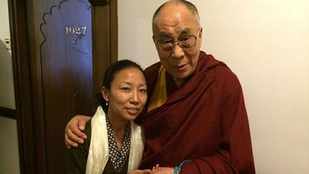Tsewang Dolma, an executive member of the Tibetan Youth Congress, with exiled Tibetan spiritual leader, the Dalai Lama, in undated photo.